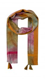 Fine scarf in batik look blurred colors like pink orange and beige and decorated with pink and orange borders and tassels.