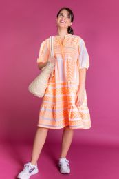 Tiered dress in neonapricot