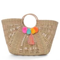 Basket bag made of straw with pompons
